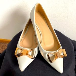 pointy grey flats with gold metal bows